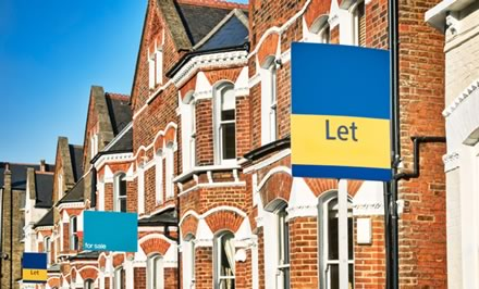 House with To Let sign