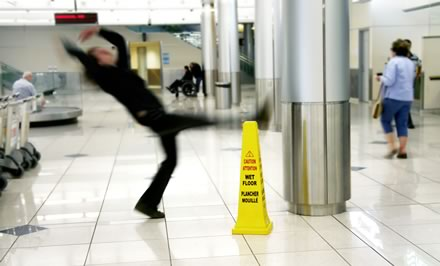 Person slipping on a wet floor